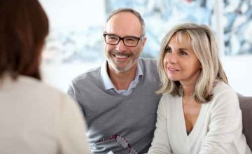 Senior couple meeting financial adviser for investment